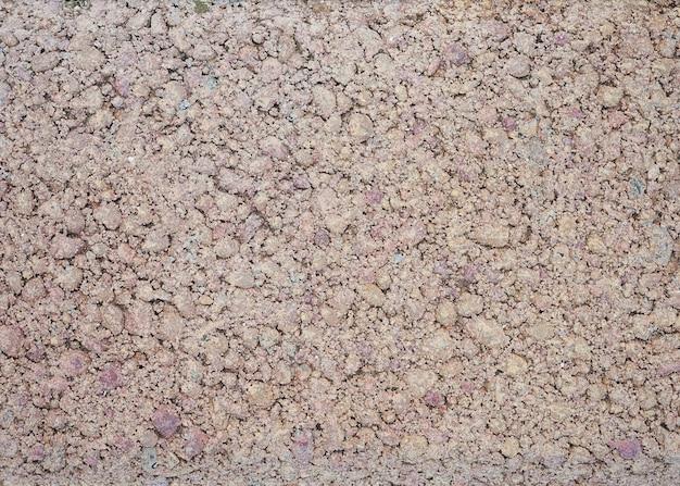 Pedra pequena textura macro granito cascalho na estrada
