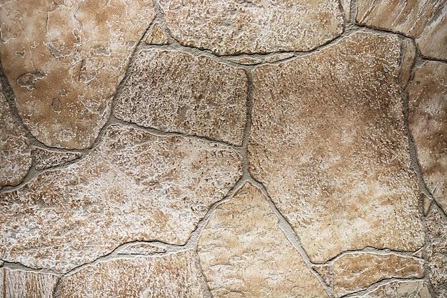 Pedra porosa marrom de fundo com linhas