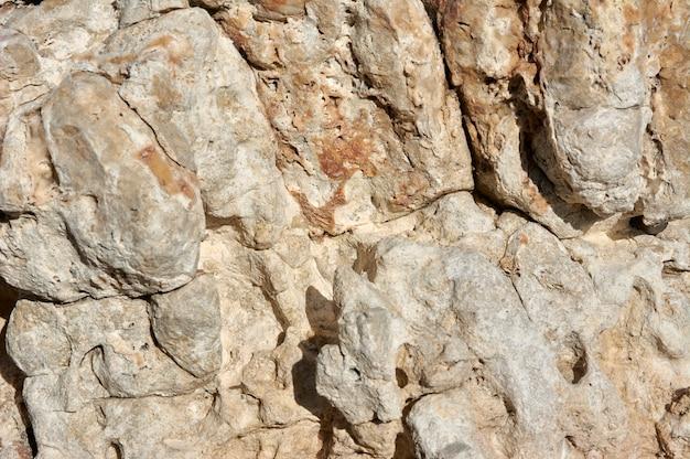 Pedra texturizada, arenito, superfície de calcário. fechar imagem. pedra, textura abstrata natural para fundos. fechar-se. papel de parede, arquitetura.