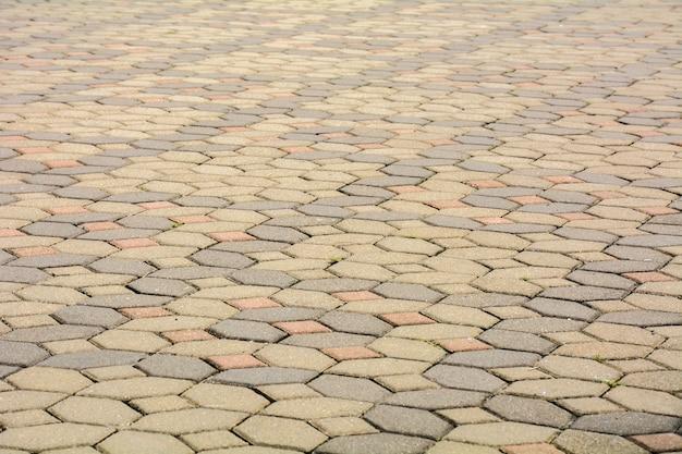 Pedras de pavimentação de tijolo em uma calçada