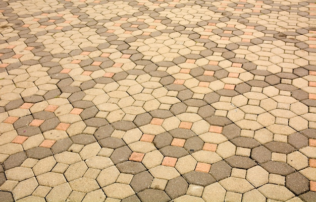 Pedras de pavimentação de tijolo em uma textura de fundo de calçada