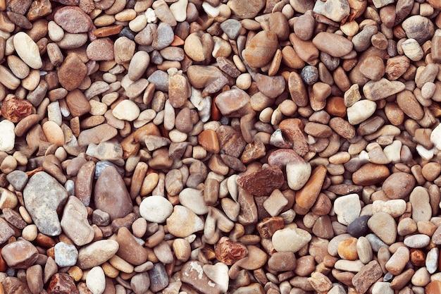Pedras do mar fundo de textura de cascalho de pedras pequenaspile