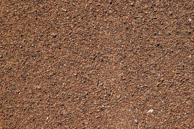 Pedras do mar. fundo de textura de cascalho de pequenas pedras