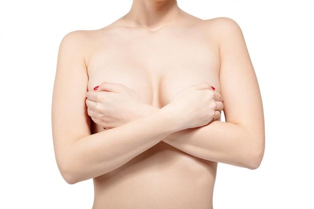 Peito feminino controlando para câncer, isolado