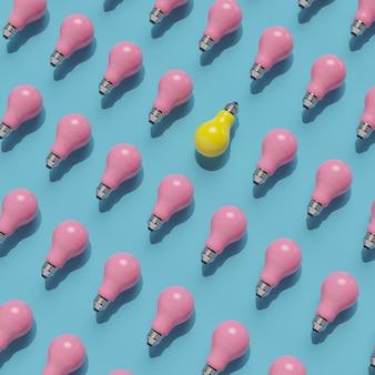 Pense diferente. lâmpada amarela pendente com lâmpada rosa sobre fundo azul. conceito mínimo