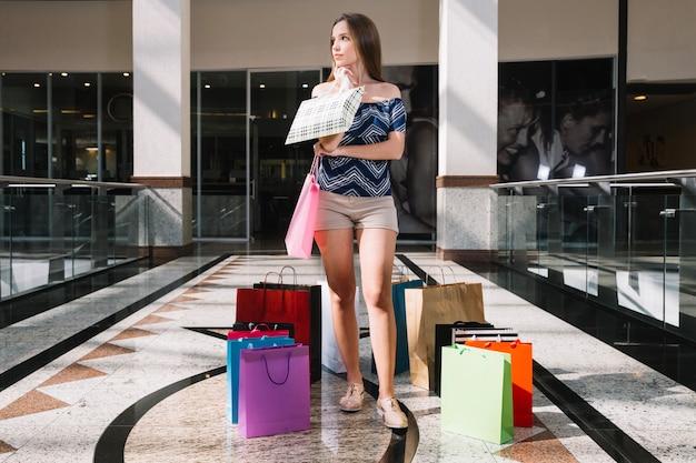 Pensive girl in shopping center