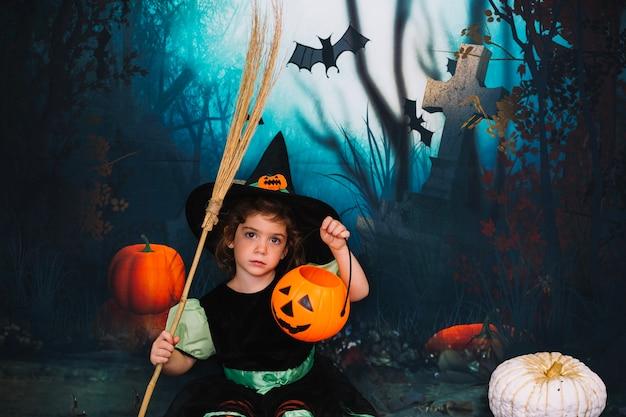 Pequena bruxa no cemitério