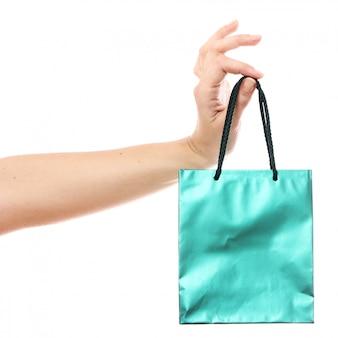 Pequena sacola de compras na mão