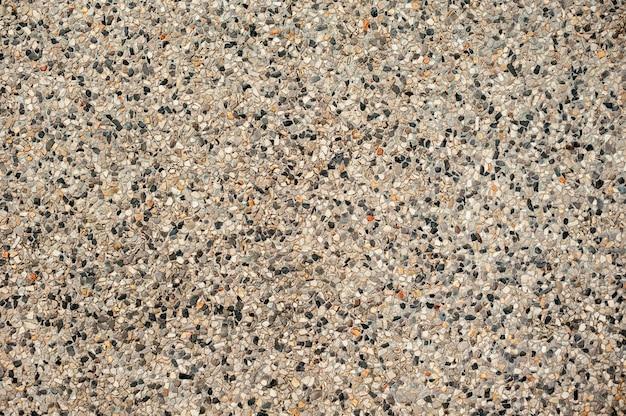 Pequenas pedras e areia em concreto