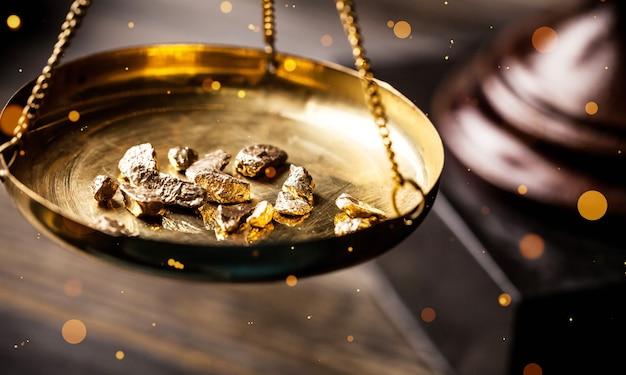 Pequenas pepitas de ouro em uma medida antiga