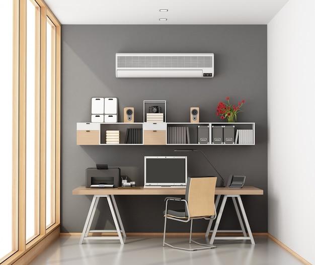 Pequeno escritório em casa com o laptop na mesa
