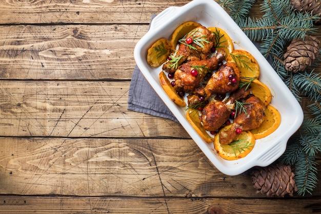 Pernas de frango assadas com laranjas e cranberries