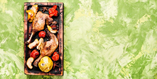 Pernas de pato com guarnição de legumes