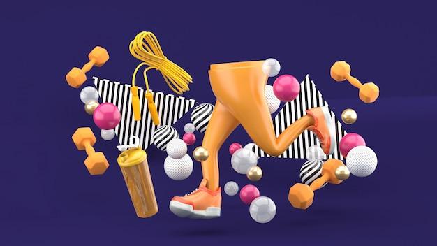Pernas e tênis e equipamentos de ginástica em meio a bolas coloridas em roxo. renderização em 3d.