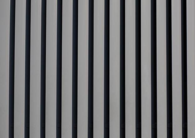 Persianas de metal cinza verticais como fundo