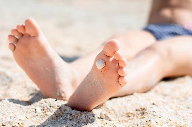 Pés na areia