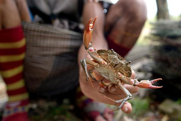 Pescador e seu caranguejo