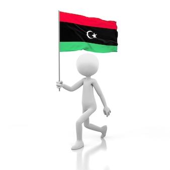 Pessoa pequena andando com a bandeira da líbia na mão. renderização de imagem 3d