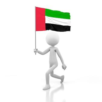 Pessoa pequena andando com a bandeira dos emirados árabes unidos na mão. renderização de imagem 3d