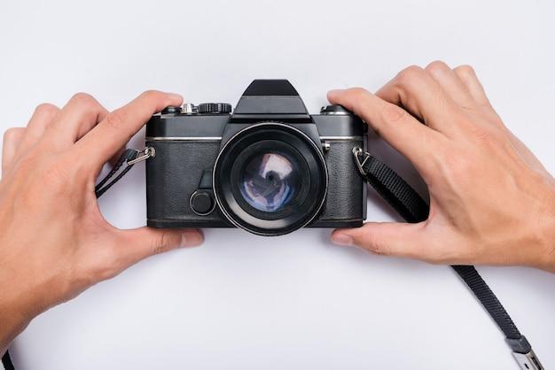 Pessoa, segurando, câmera clássica