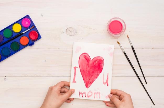 Pessoa, segurando, te amo, mãe, inscrição