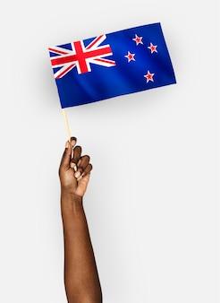 Pessoa, waving, a, bandeira, de, nova zelândia