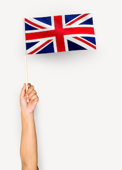 Pessoa, waving, a, bandeira, de, reino unido, de, grã bretanha, e, irlanda norte