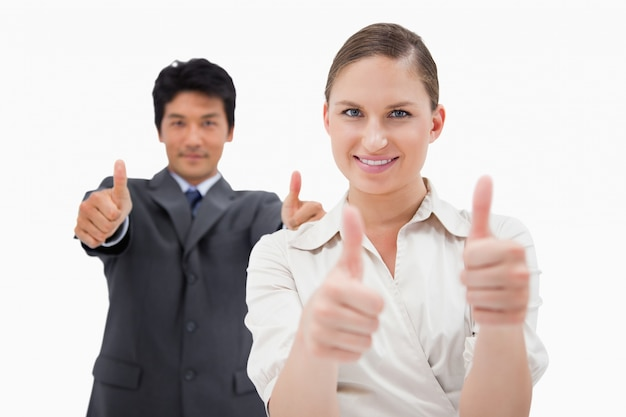 Pessoas de negócios com os polegares para cima