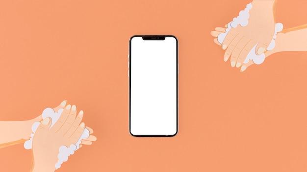 Pessoas lavando as mãos ao lado de um telefone em branco
