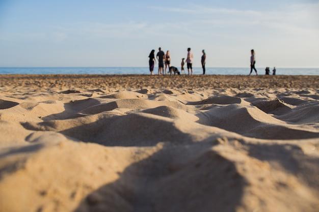 Pessoas na areia