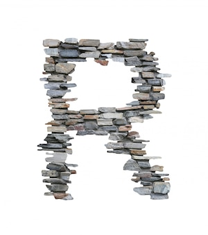Pia batismal de r para criar da parede de pedra isolada no branco.