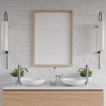 Pia branca do banheiro que está o quadro branco na prateleira do armário.