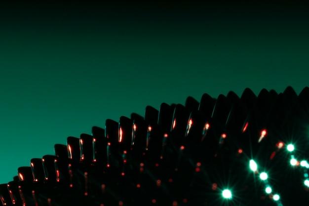 Picos de brilho close-up metal ferromagnético