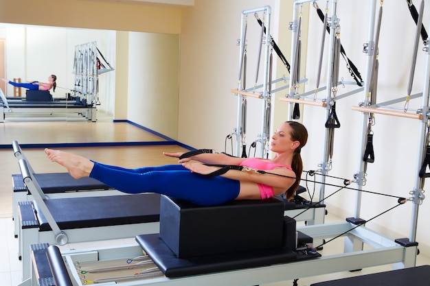 Pilates reformer woman back stroke exercise