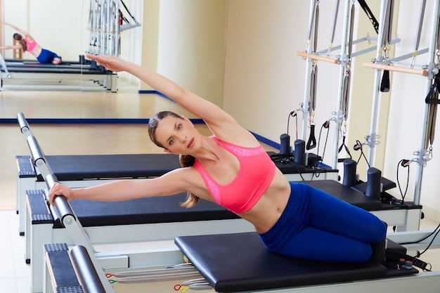 Pilates reformer woman mermaid exercise