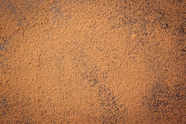 Pilha de cacau em pó, fundo de um pó de cacau marrom seco, pilha de cacau em pó fresco, cacau em pó vista superior fundo