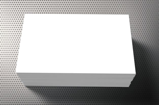 Pilha de cartões de visita em branco em fundo cinza