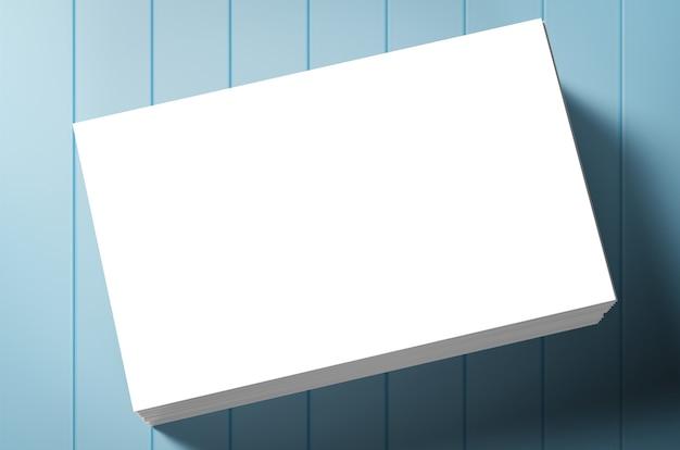 Pilha de cartões de visita em branco sobre fundo azul
