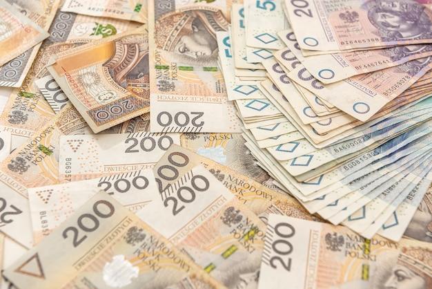 Pilha de dinheiro polonês diferente. fechar-se. conceito financeiro