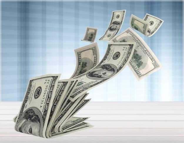Pilha de dinheiro voando no fundo