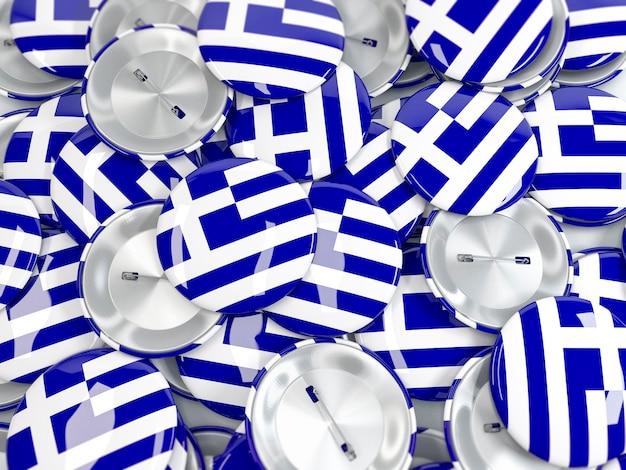 Pilha de emblemas de botão com bandeira da grécia. renderização 3d realista