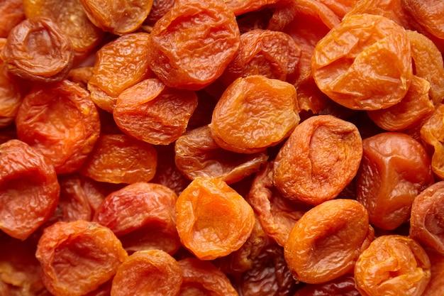Pilha de frutas secas de damasco fundo alimentar