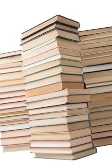 Pilha de livros antigos artísticos empilhados em fundo branco