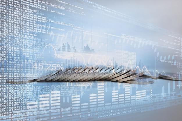 Pilha de moedas de dinheiro com gráfico comercial para investidores financeiros. economia digital da criptomoeda. conceito de plano de fundo de investimento financeiro.