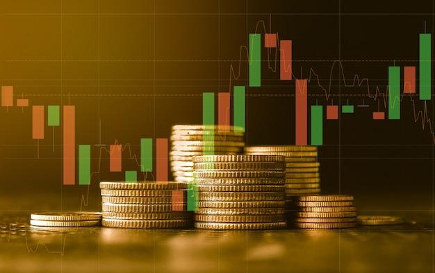 Pilha de moedas de ouro com conceito de investimento financeiro de gráfico comercial pode ser usada como pano de fundo