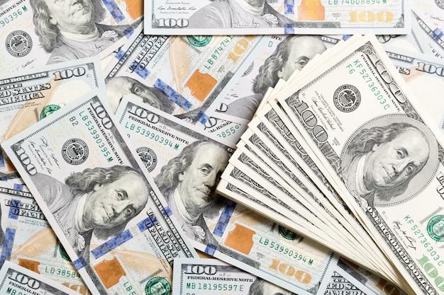 Pilha de notas de dólar americano, fundo de dinheiro. vista superior do conceito de negócio no fundo com espaço de cópia