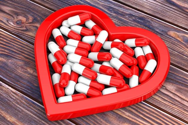 Pilha de pílulas de saúde em forma de coração vermelho em uma mesa de madeira. renderização 3d
