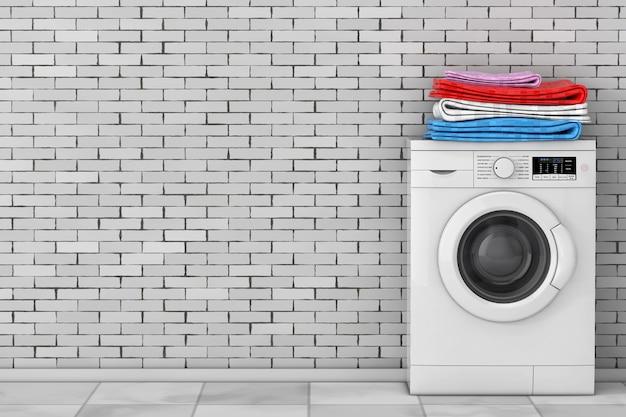 Pilha de roupas sobre a moderna máquina de lavar na frente da parede de tijolos. renderização 3d