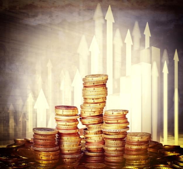 Pilhas de moedas de euro e gráfico