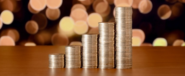 Pilhas de moedas de ouro organizadas como um gráfico
